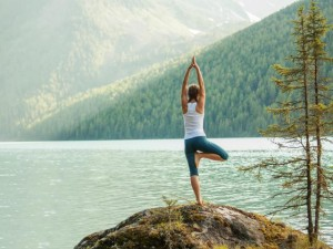 woman_tree_pose_yoga_shutterstock__medium_4x3